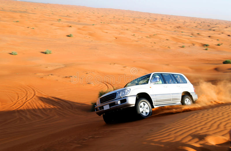 Offroad car. Scenic view of off road motor car in sandy desert stock images