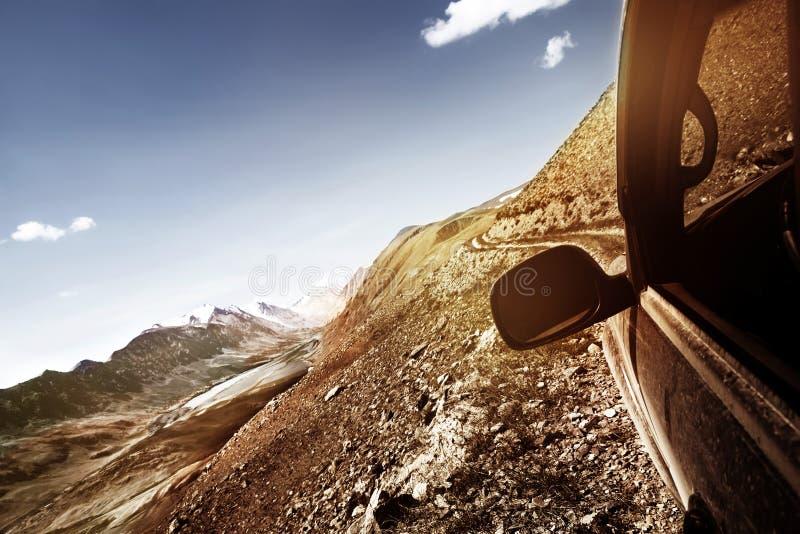 Offroad car climbing mountain pass royalty free stock photography