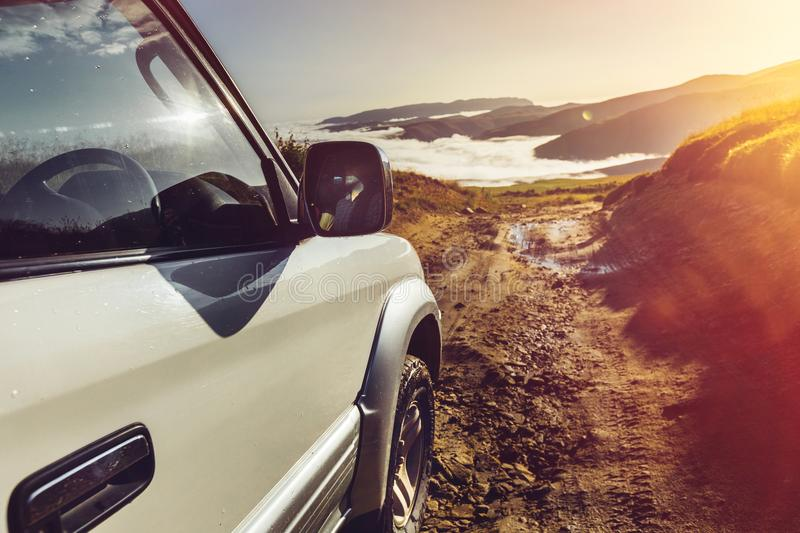 Offroad Car On Mountains And Clouds Background. Road Adventure V. Off-road Car On Mountains And Clouds Background. Road Adventure Holidays Vacation Concept stock photos
