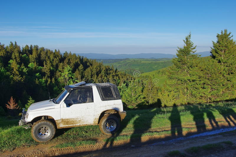 Offroad car on the mountains royalty free stock photo