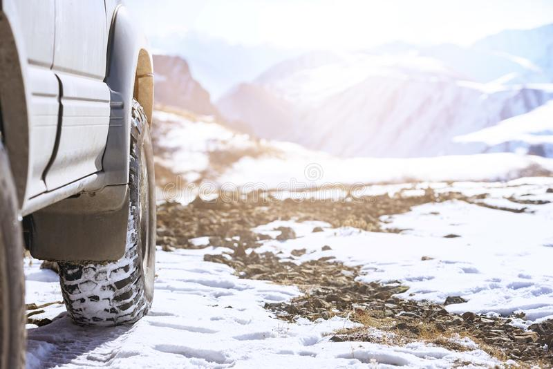 Offroad car wheel 4x4 winter tires snow. Offroad 4x4 car wheel on snow surface. Winter tires concept royalty free stock photos