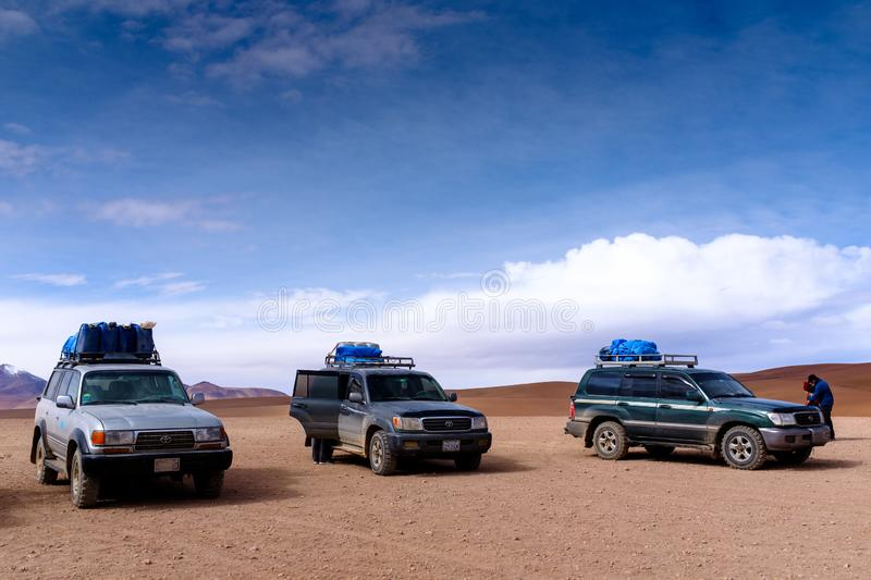Offroad cars parked in a desert. Three Toyota Land Cruiser offroad cars parked in a desert at the Eduardo Avaroa Andean Fauna National Reserve in southwestern stock photography