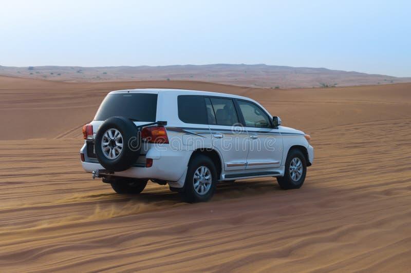 Offroad Desert Safari - Dune bashing with 4x4 vehicle in the Arabian sand dunes, Dubai, UAE. 4x4 SUV dune bashing in the Arabian desert close to Dubai, UAE royalty free stock photo