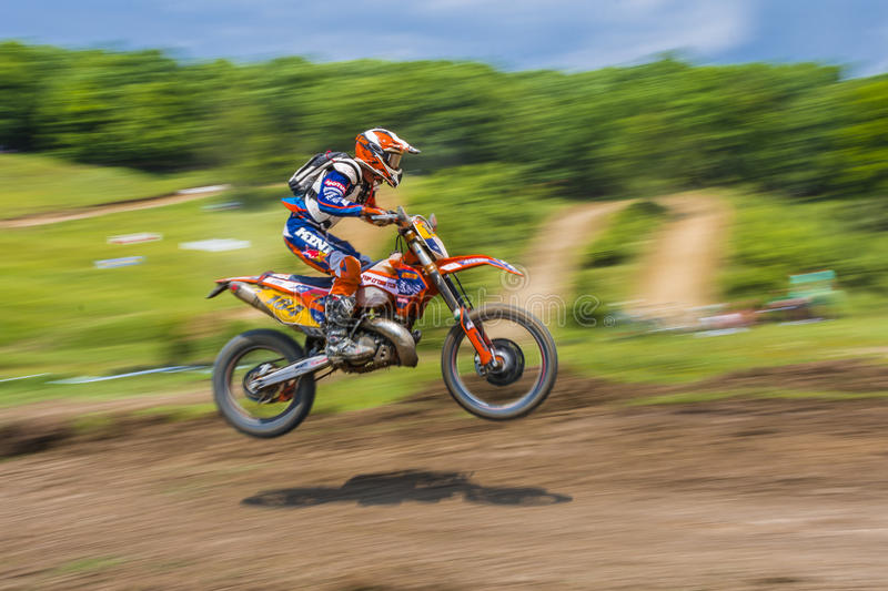 Offroad motorcycle. Racer on motorcycle during an offroad competition on June 20, 2015 in Bucharest, Romania stock image