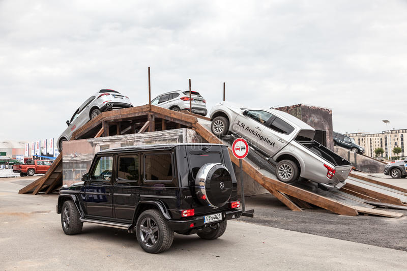 Offroad parcours at the IAA 2015 in Frankfurt, Germany. FRANKFURT, GERMANY - SEP 22: Luxury SUVs driving at an offroad parcours of the IAA International Motor stock photos