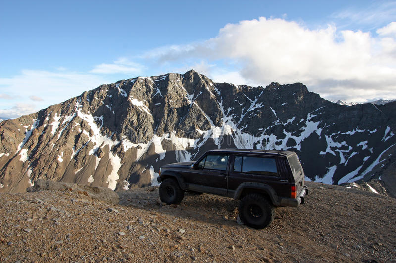Offroad vehicle high in the Coast Mountains of British Columbia. Offroad vehicle high in the Coast Mountains of British Columbia, Canada. Molybdenite Peak in royalty free stock photos