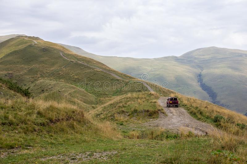 Offroad vehicle on the mountain terrain. Offroad vehicle on the wild nature mountain terrain royalty free stock image