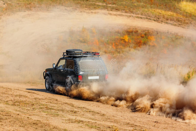 Offroad vehicle on rally competition. Offroad vehicle in motion on rally competition royalty free stock photos