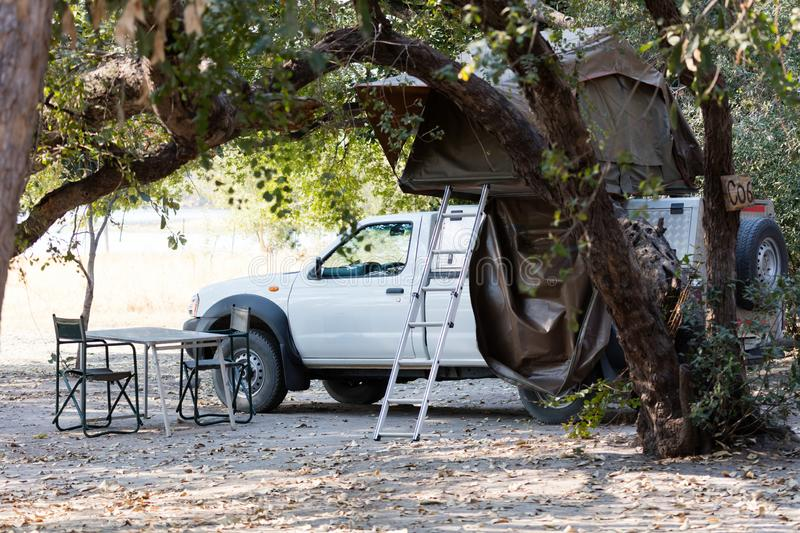 Offroad 4x4 vehicle with tent in the roof. Ready for camping in the desert royalty free stock image