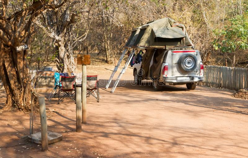 Offroad 4x4 vehicle with tent in the roof. Ready for camping in the desert royalty free stock images