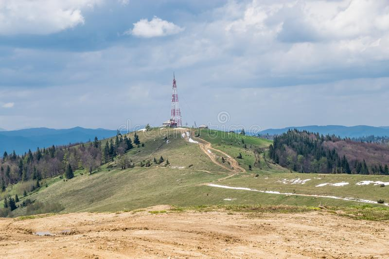 Offroad way to the telecommunication tower stock images
