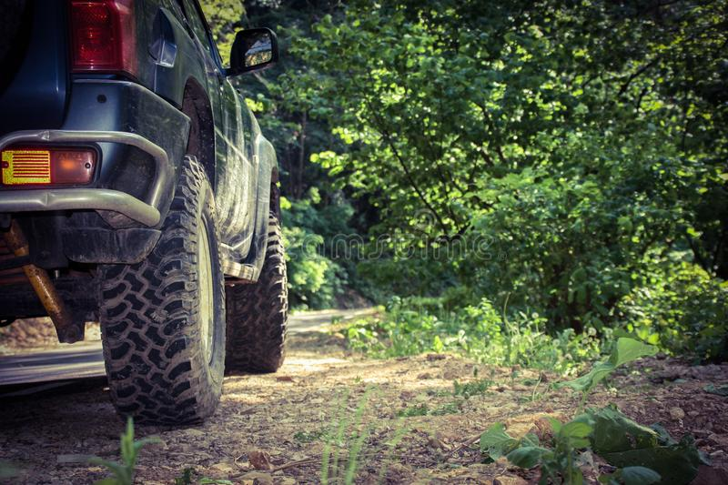 Offroad through the wild mountains of Romania. A powerful engine and good tires perform well on muddy and rough roads. Symbol of freedom and independence stock images