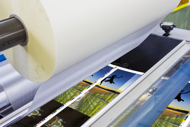 Offset machine press print run at table stock image