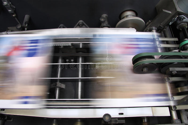 Offset machine - Press printing. The equipment for a press in a modern printing house stock image