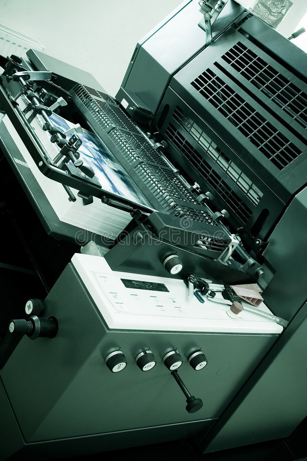 Offset Printing Machine. Closeup of an Offset Printing Machine in print shop stock image