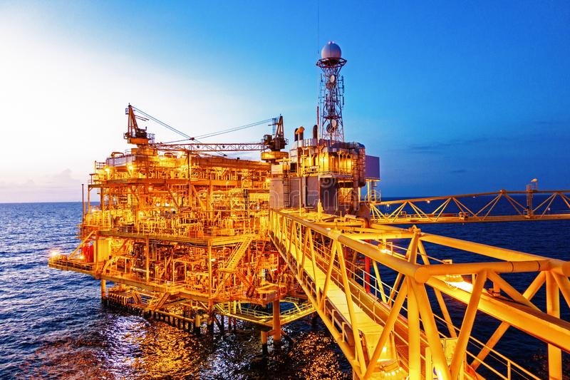 Offshore construction platform for production oil and gas with b. Ridge in evening time for industrial business concept stock photography