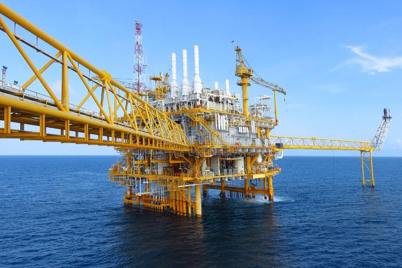 Offshore construction platform for production oil and gas, Oil and gas industry and hard work,Production platform stock image