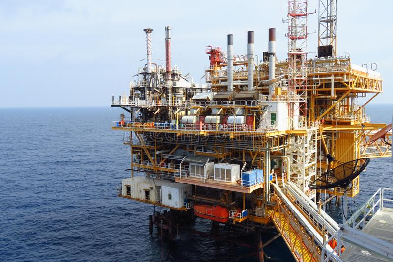 Offshore construction platform for production oil and gas, Oil and gas industry and hard work,Production platform stock images