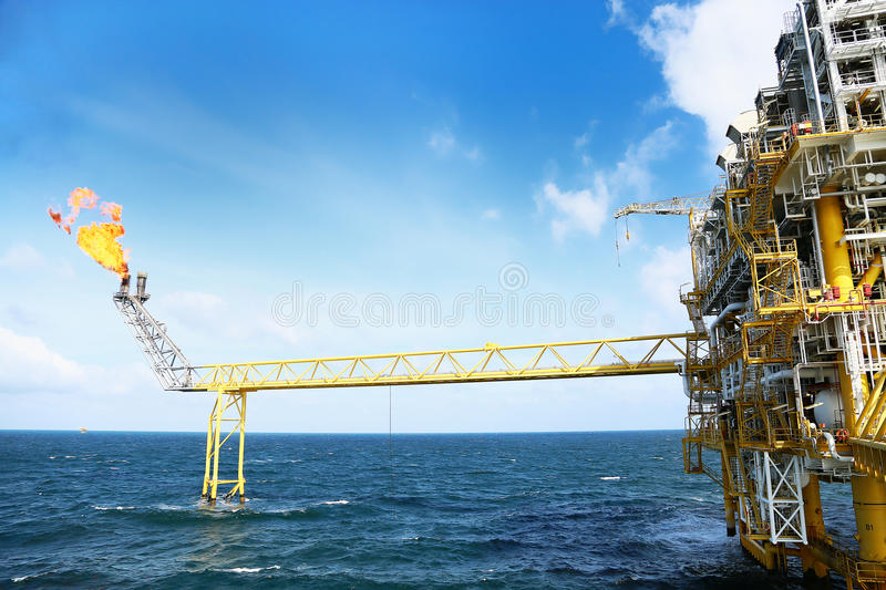Offshore construction platform for production oil and gas. Oil and gas industry and hard work industry. Production platform. And operation process by manual and royalty free stock photography