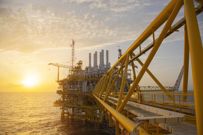 Offshore construction platform for production oil and gas. Oil and gas industry and hard work. Production platform and operation. Process by manual and auto stock photo