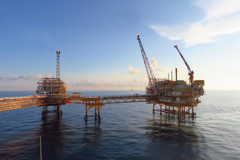 Offshore construction platform for production oil and gas, Oil and gas industry and hard work,Production platform. And operation process by manual and auto royalty free stock photo