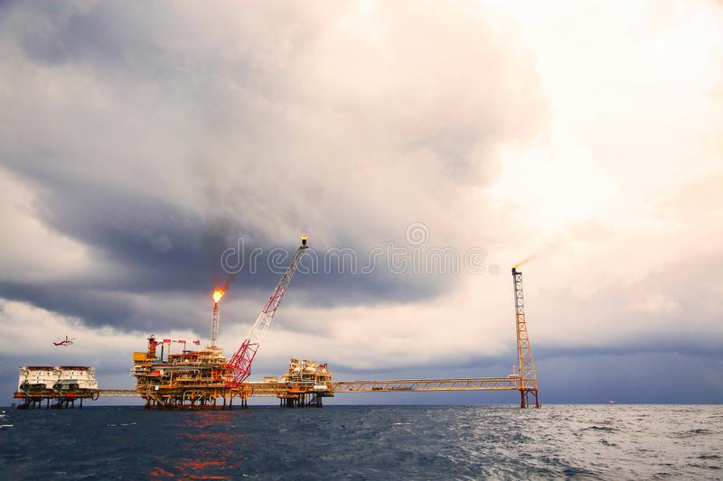 Offshore construction platform for production oil and gas. Oil and gas industry and hard work. Production platform and operation. Process by manual and auto stock images