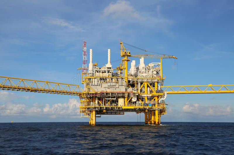 Offshore construction platform for production oil and gas, Oil and gas industry and hard work, Production platform and operation. Process by manual and auto stock photography