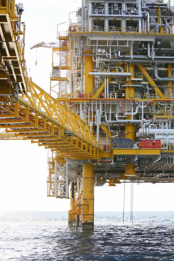 Offshore construction platform for production oil and gas, Oil and gas industry and hard work, Production platform and operation. Process by manual and auto stock images