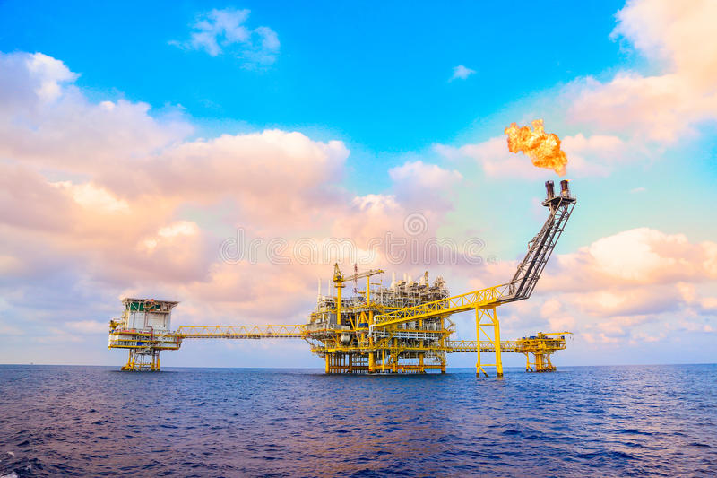 Offshore construction platform for production oil and gas, Oil and gas industry and hard work,Production platform and operation. Process by manual and auto stock photography