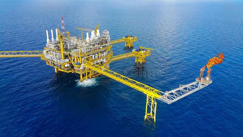 Offshore construction platform for production oil and gas, Oil and gas industry and hard work,Production platform and operation. Process by manual and auto stock photo