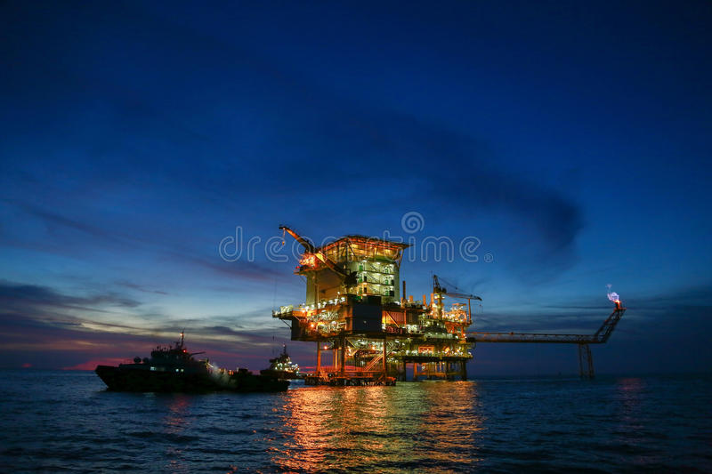 Offshore construction platform for production oil and gas, Oil and gas industry and hard work,Production platform. And operation process by manual and auto royalty free stock image
