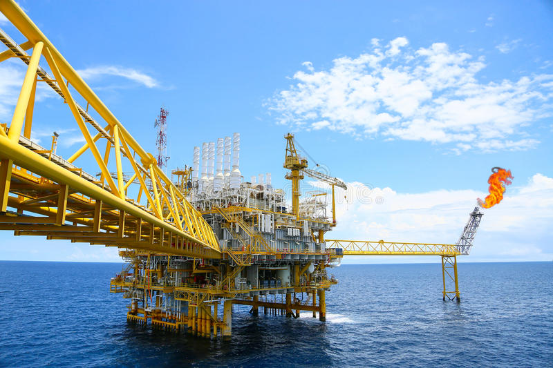 Offshore construction platform for production oil and gas, Oil and gas industry and hard work,Production platform and operation. Process by manual and auto stock image
