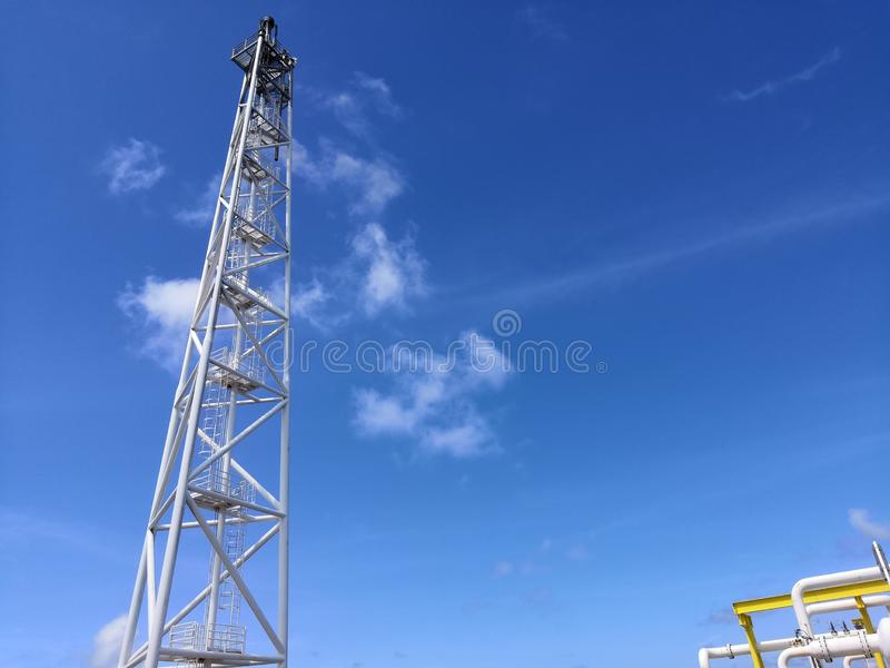 Offshore crude oil flare tower. Onboard fpso vessel located south east asia stock photos