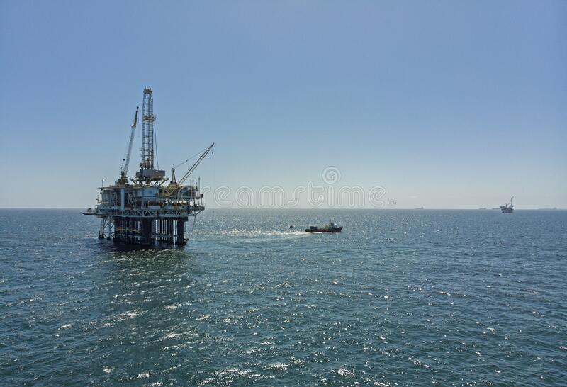 Offshore drilling Oil platform View from Boat stock photo