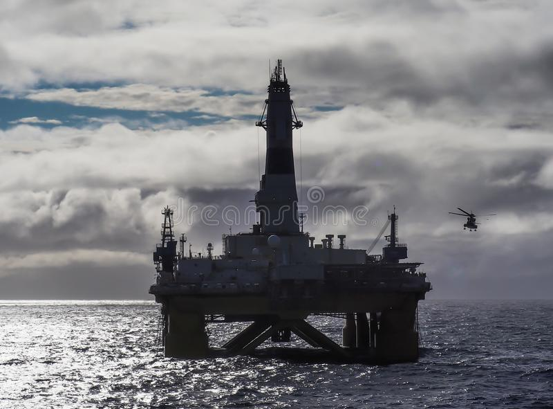 Offshore drilling rig in Gulf of Mexico, petroleum industry, with helicopter. Offshore drilling rig or platform in Gulf of Mexico, petroleum industry, with royalty free stock image
