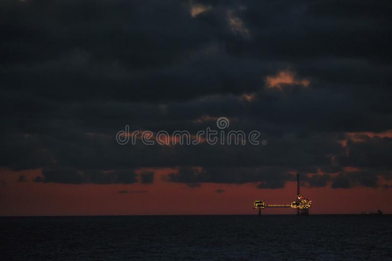 Offshore drilling rig under construction. Oil industry structure. Oil platform at night royalty free stock photo