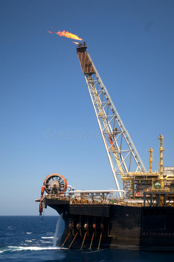 Offshore FPSO oil rig. Bow view of an offshore floating production, storage and offloading oil rig. Coast of Brazil, circa 2010 stock image
