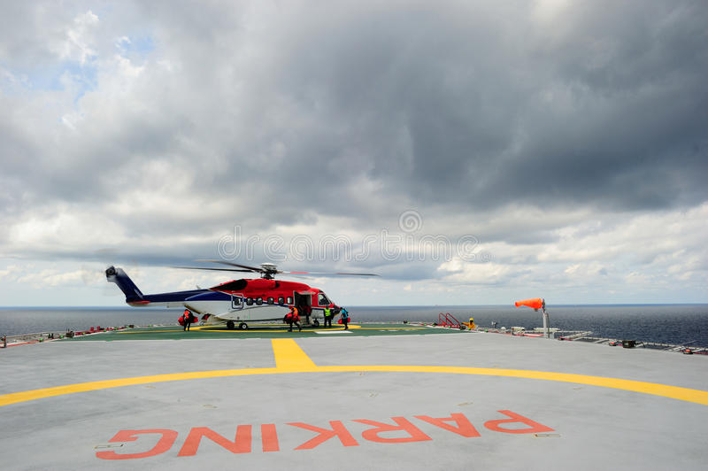 An offshore helicopter on the helideck royalty free stock photo