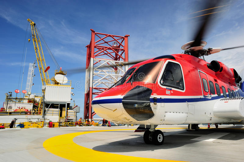 An offshore helicopter on the helideck stock image