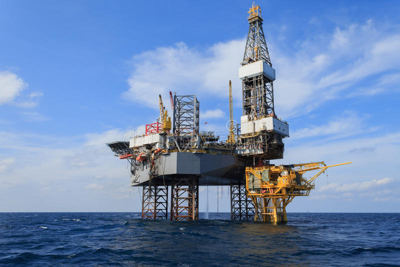 Offshore Jack Up Drilling Rig Over The Production Platform. In The Middle of The Sea royalty free stock photos