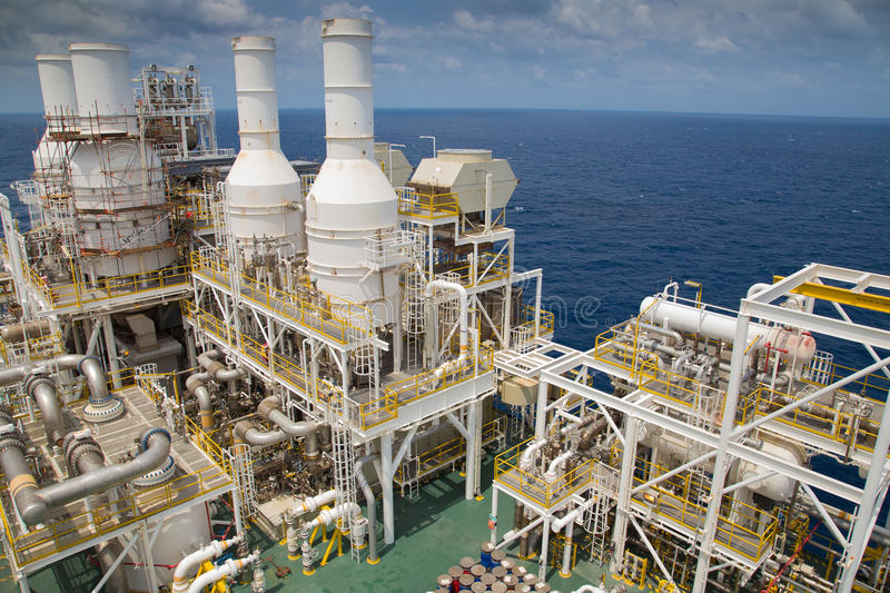 Offshore oil and gas business in the gulf of Thailand,Oil and gas production platform at the top of deck. stock image