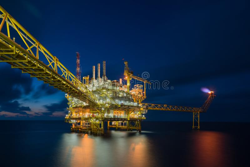 Offshore oil and gas central facility produce raw gas condensate and crude oil and then treat for sent to onshore refinery. And petrochemical industry and royalty free stock photography