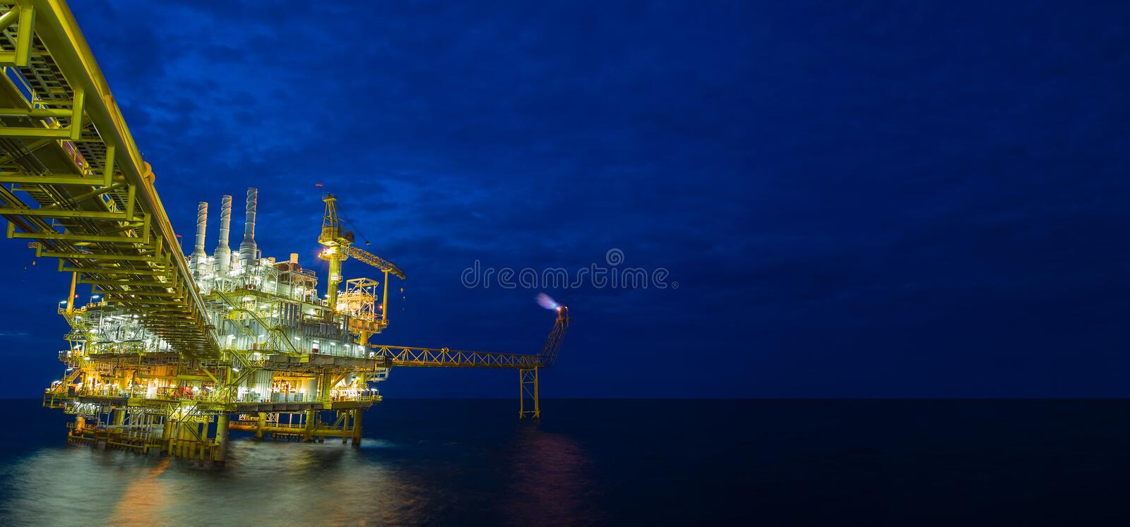Offshore oil and gas central processing platform in the gulf of Thailand. Offshore oil and gas central processing platform in the gulf of Thailand in twilight stock photo
