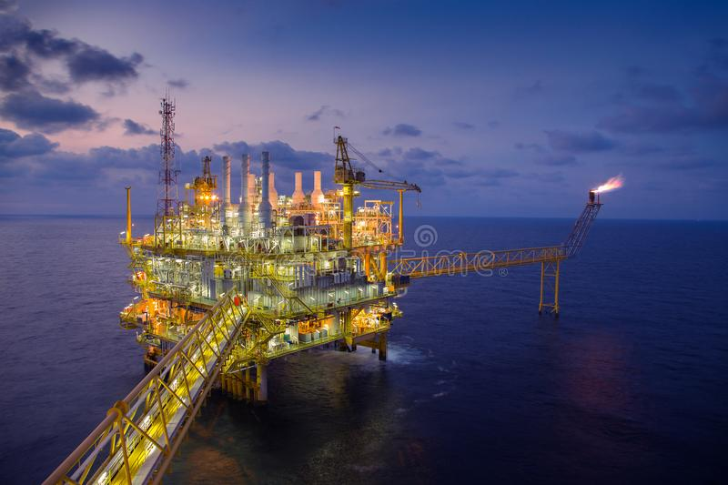 Offshore oil and gas central processing platform produced gas and crude then sent to onshore refinery.  stock images