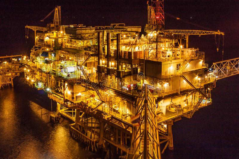 Offshore oil and Gas central processing platform and remote plat stock photo