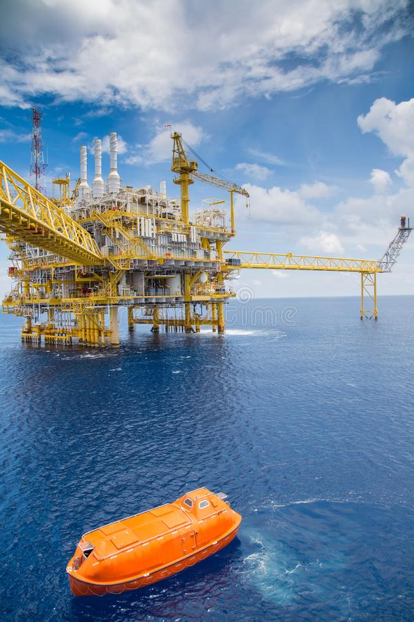 Offshore oil and gas central processing platform, rescue boat driving thought process platform for annual testing to evacuate. Offshore oil and gas central royalty free stock images
