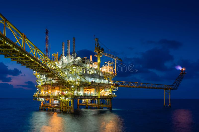 Offshore oil and gas construction platform in sun set where produced raw gases and crude for set to onshore refinery. Offshore oil and gas construction platform stock photos