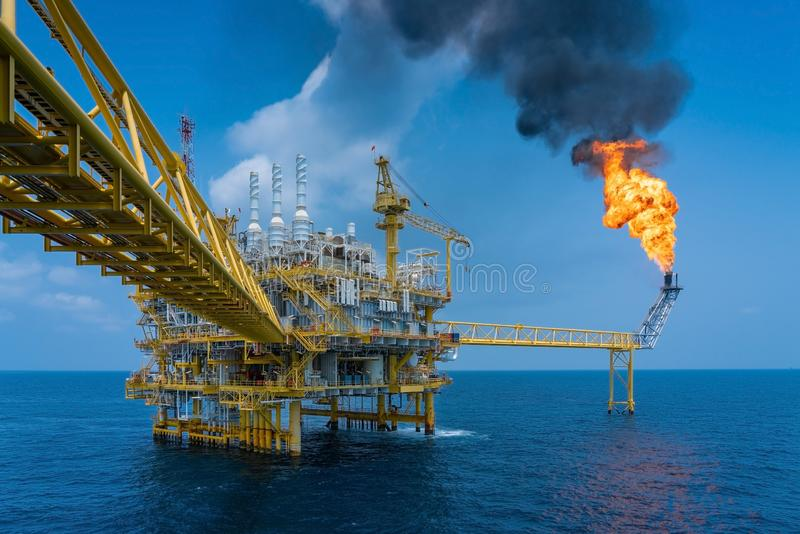 Offshore oil and gas construction platform while vent gases to flare platform to prevent over pressure from process upset. Offshore oil and gas construction stock photos