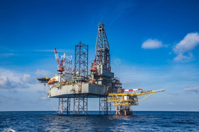 Offshore oil and gas drilling rig while completion well on oil a. Nd gas wellhead remote platform stock photos