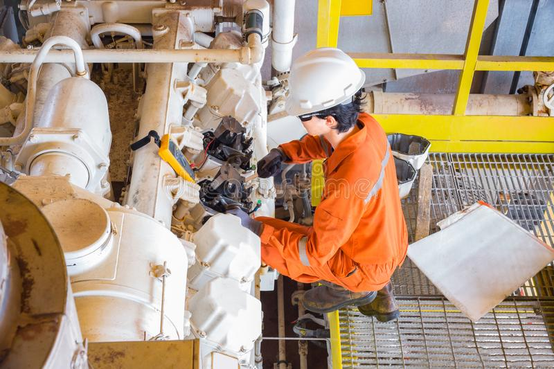 Offshore oil and gas multi skill operator Electrical, Instrument and Mechanical while maintenance gas engine compressor at oil royalty free stock photo